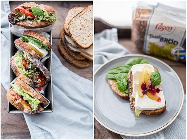 Leckere Sandwiches in Butterbrotpapier gehüllt in einen Backform angerichtet